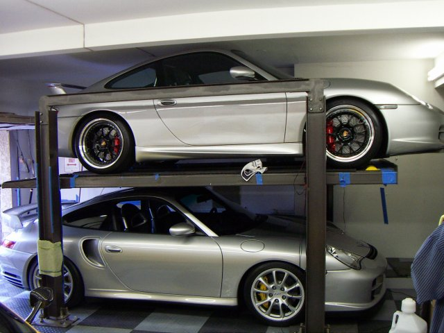 i wish i had the cars on the lifts my next house requirement is at least a 3 car garage with enough clearance to install one