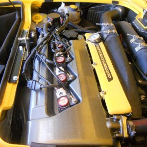engine bay with recently mounted Okadata ignition coils and Hyper Ignition system