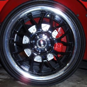 11 inch drilled/slotted/vented rotors and 4 piston calipers on S2 Esprit