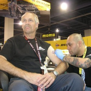 My first tattoo at SEMA Show to receive a free set of Dunlop tires.